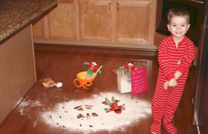 elf making snow angels in flour