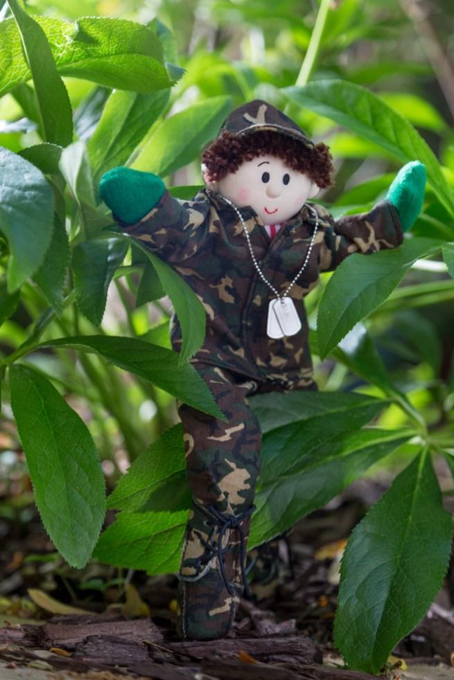 elf hiding in planter