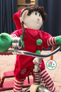 Elf riding a tricycle