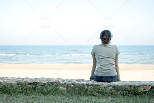 woman sitting alone looking