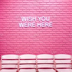 Neon Pink Chair Single Bed A Brick Wall With Empty Chairs And Sign Saying Wish You Were Get Permission To Sell