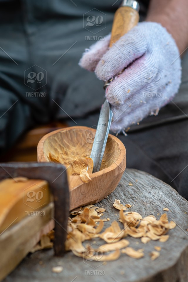 Craftsman Demonstrates The Process Of Making Wooden Spoons Handmade Using Tools National Crafts Concept Wooden Design Handmade Traditional Old Wood Craft Making Craftsman National Hands Carving Spoons Work Equipment Construction Tool