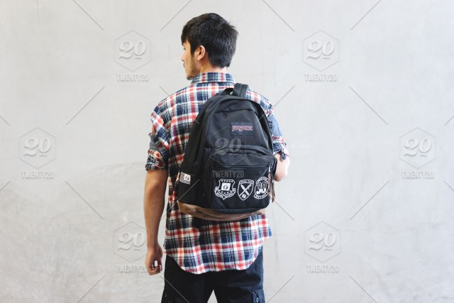 young guy with backpack