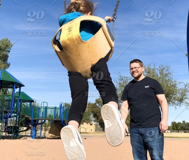 Man Pushing Little Girl On Swing In Playground Child Fun Outdoors Playground Swing People Enjoyment Joy Cute Vertical Leisure Activity