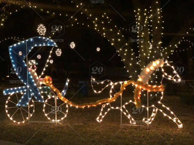 Horse And Buggy Christmas Decoration Night Shot Bright And Colorful Stock Photo 44e6ae1d 96f1 4d2a 9215 D424ce361e8e