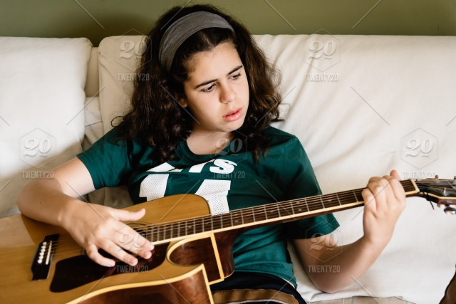 girl practicing chords on