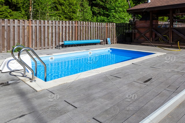 swimming pool patio area and barbecue