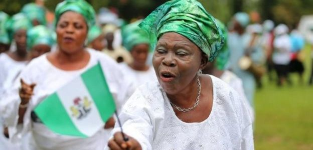nigerian woman holding the flag