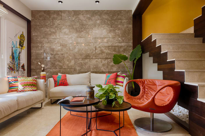 orange living room designs open plan kitchen dining plans 1 000 design decoration ideas urbanclap beige abstract wall and cream sofas with patterned cushions lounge chair