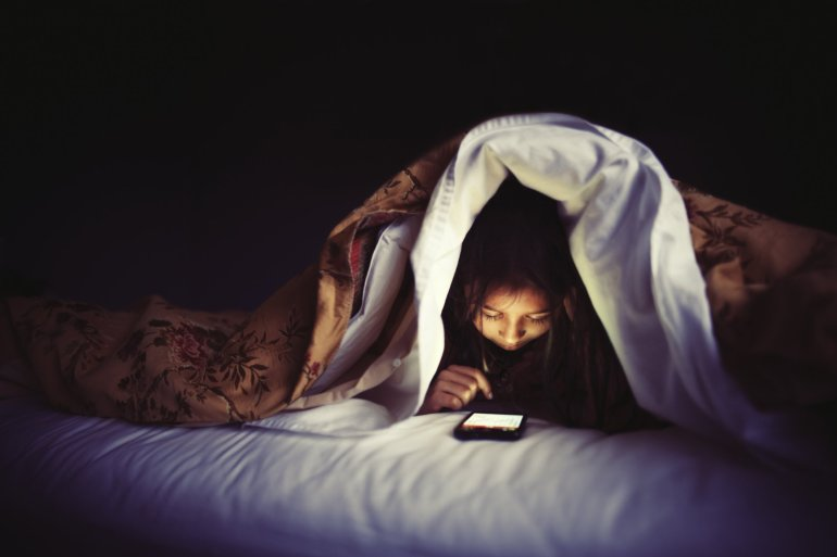 Image result for playing phone in the dark