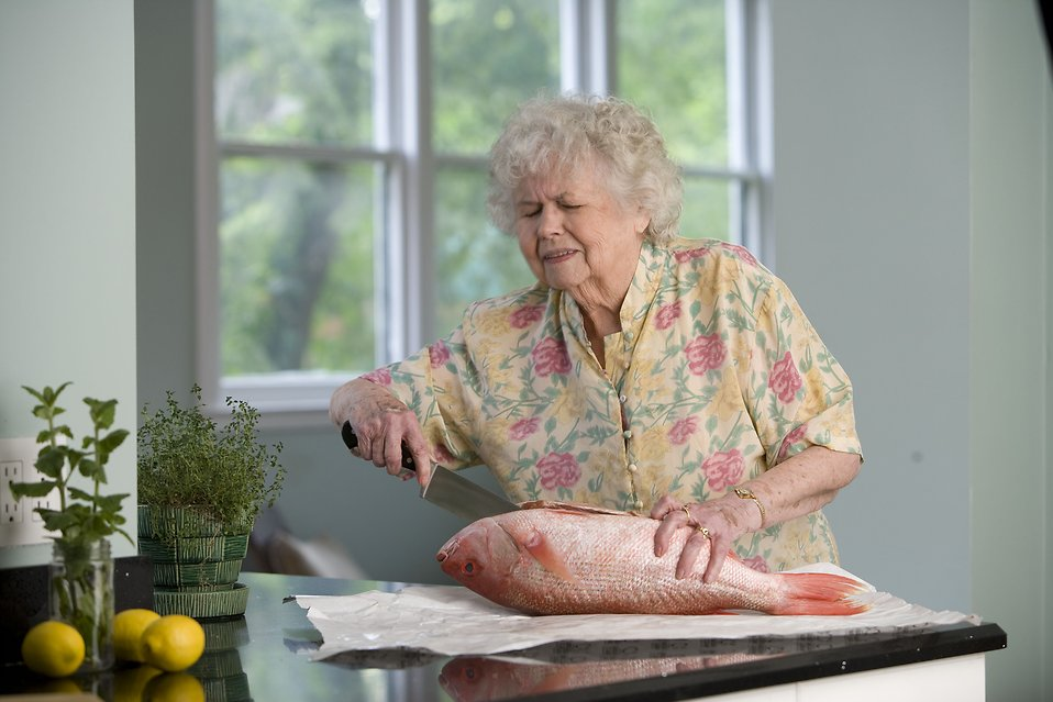 Fish Food Free Stock Photo An Elderly Woman Preparing