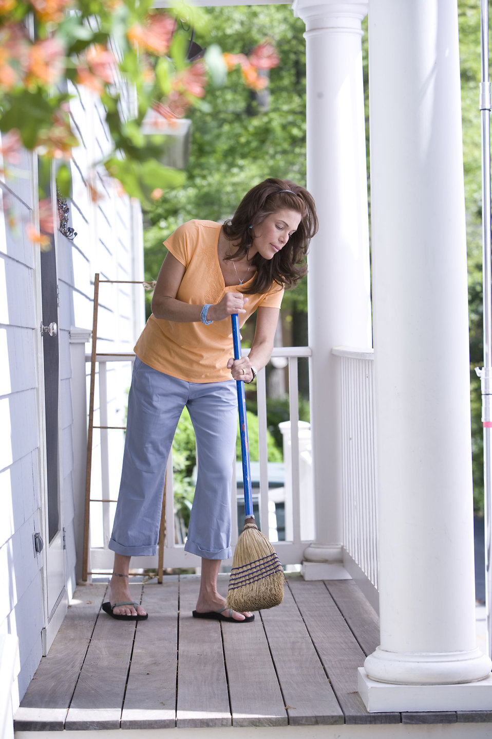 Sweeping  Free Stock Photo  A woman sweeping her front