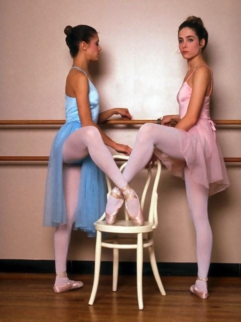 Ballet Girls  Free Stock Photo  Two beautiful young ballerinas posing with a chair   2583