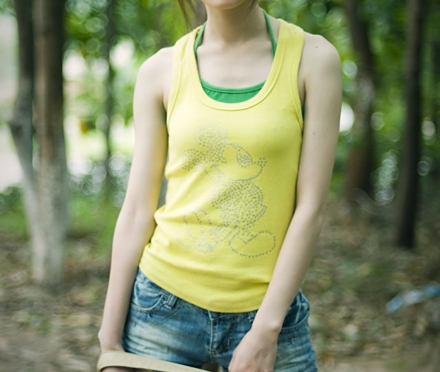 A Beautiful Chinese Girl Posing In The Woods Free Stock Photo