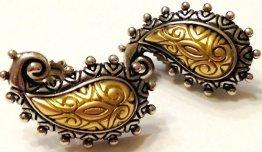 All-metal paisley button earrings; post backs.