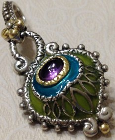 Enamel peacock charm with amethyst cabochon.