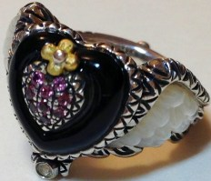 Winged heart ring with mother-of-pearl, onyx, and pink garnet.
