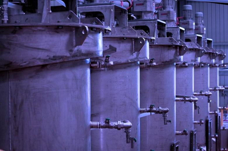 Close-up of metal processing vats