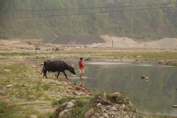 Sediment mining in a river bed, Nepal