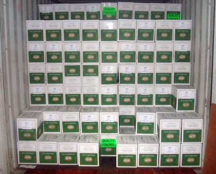 """Figure 3: The cartons that have been instrumented are easily recognizable by the green labels that say """"Quality Control"""""""