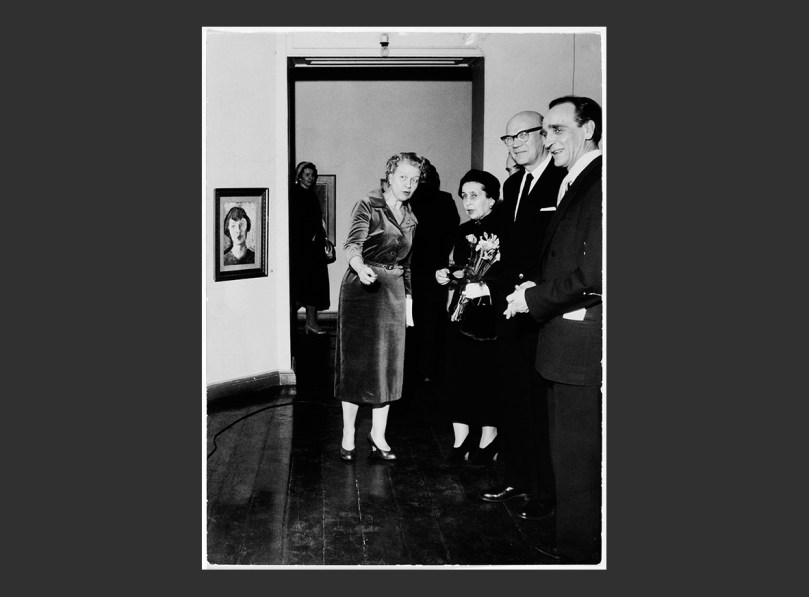 The 1958 retrospective exhibition of the Finnish painter Tyko Sallinen at the Ateneum Art Museum. Director Aune Lindström (far left) and the show's curator Deputy Director Einari J. Vehmas (far right) welcome the Finnish President Urho Kekkonen and his wife. Photo: Archive Collections, Finnish National Gallery. Photographer unknown.