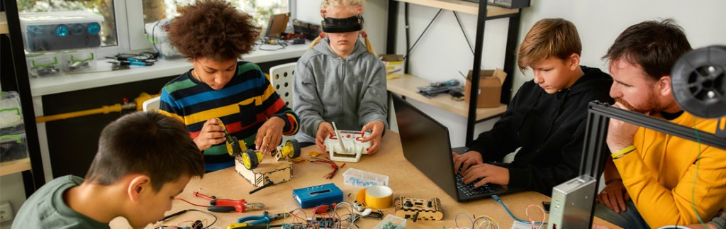 Children in a classroom experiment with technology