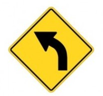 A yellow caution left turn sign