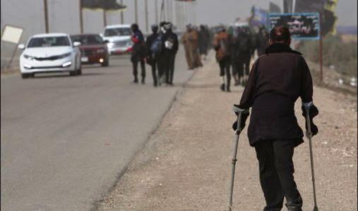 Un fidèle handicapé sur le chemin du pèlerinage