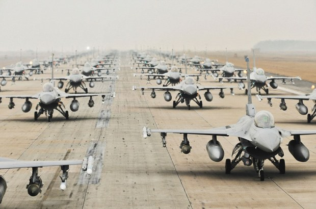 """Mandatory Credit: Photo by Brittany Y. Auld/USAF / Rex Features (2095646l)  F-16 Fighting Falcons from the 35th and 80th Fighter Squadrons of the 8th Fighter Wing, Kunsan Air Base, South Korea; the 421st Expeditionary Fighter Squadron of the 388th FW at Hill AFB, Utah; the 55th EFS from the 20th FW at Shaw AFB, S.C.; and from the 38th Fighter Group of the South Korean air force, demonstrate an """"Elephant Walk"""" as they taxi down a runway during an exercise at Kunsan Air Base, South Korea, March 2, 2012. The exercise showcased Kunsan AB aircrews' capability to quickly and safely prepare an aircraft for a wartime mission. (U.S. Air Force photo by Senior Airman Brittany Y. Auld)  Amazing Images Show U.S. Air Force's Year In Pictures  This amazing gallery of images highlights the very best photography from the U.S. Air Force.    The stunning selection was made by a team of Air Force journalists and photographers who were tasked with choosing the best photos from around the Air Force for the 2012 Air Force Year in Photos.    They range from a triumphant fly-by of an American football game in Foxboro, Massachusetts to snoozing Airman Basic Rebecca Perez taking a break from patrol during a field training exercise in Maryland.    A U.S.A.F. spokesperson says: """"These photos showcase Airmen around the globe involved in activities supporting expeditionary operations and defending America.""""      For more information visit http://www.rexfeatures.com/stacklink/CCUKZMWDF"""