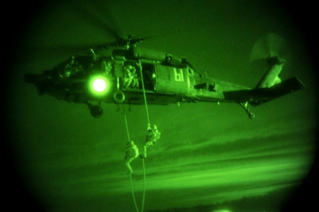 110818-N-LO372-975 STENNIS, Miss. (Aug. 18, 2011) Members of the Chilean Armed Forces perform a night-time fast rope training exercise from an MH-60L Blackhawk helicopter, piloted by Soldiers from the 160th Special Operations Aviation Regiment, during PANAMAX 2011. PANAMAX 2011 is an annual multinational training exercise sponsored by U.S. Southern Command focusing on the security of the Panama Canal. Involving 16 nations from the Western Hemisphere and more than 3,500 civil and military personnel, the 12-day exercise takes place off the coasts of Panama and the United States, including Fort Sam Houston, Texas, Miami, Naval Station Mayport, Florida and Stennis, Mississippi, among others Aug 15-26. (U.S. Navy photo by Mass Communication Specialist 1st Class Elisandro T. Diaz/Released)