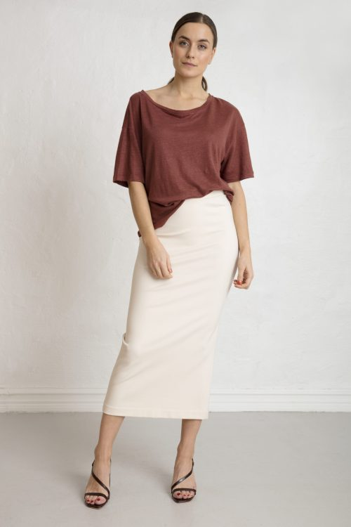 Woman in brown cinnamon linen tee