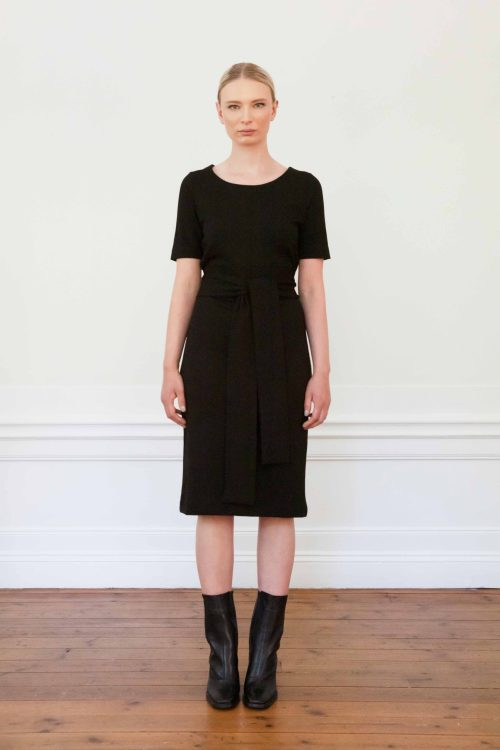 Girl wearing Lilith ecovero dress in color black