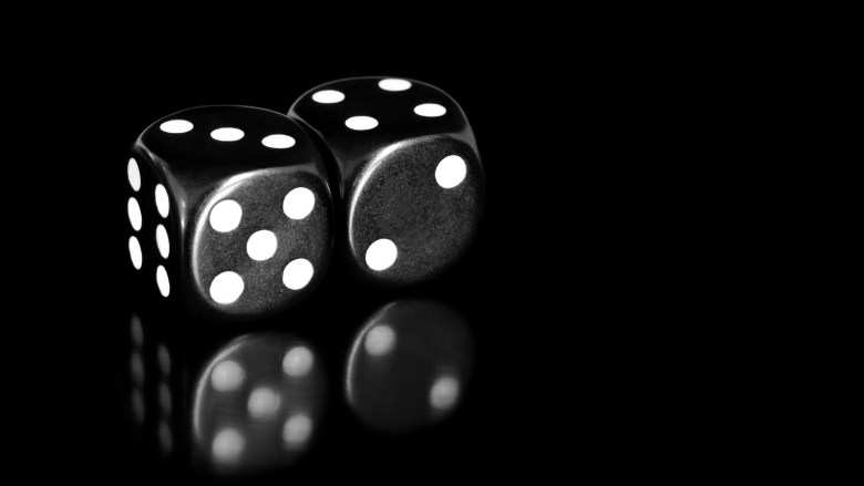 black and white dice reflected on black