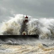 Waves enveloping lighthouse
