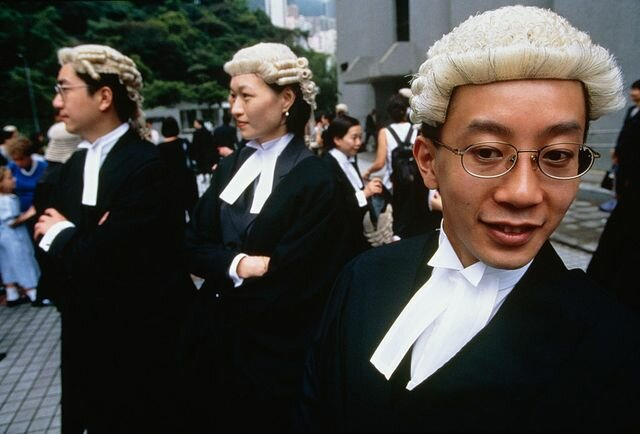 why do british lawyers