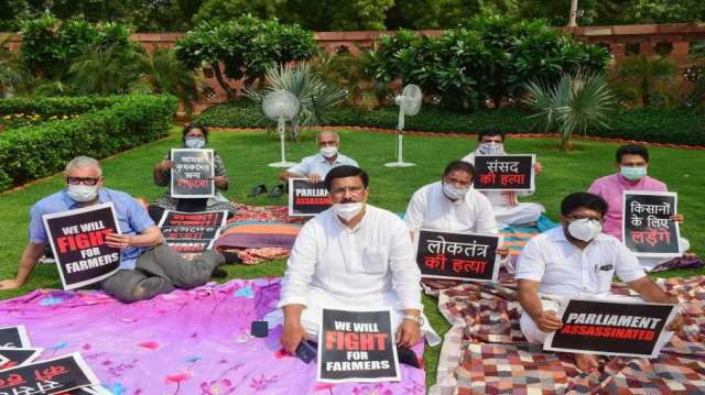 Eight suspended Rajya Sabha MPs display placards as they stage a protest over their suspension, duri- India TV Hindi