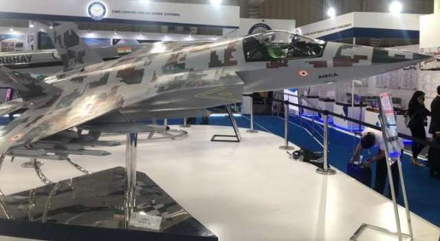 India Tv - Defence Research and Development Organisation has showcased India's under-development fifth-generation fighter aircraft Advanced Medium Combat Aircraft at Aero India. As per DRDO, the aircraft would come with stealth features and all capabilities of a multirole fighter plane.