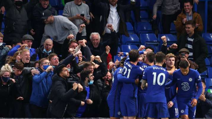 India Tv - Chelsea fans celebrate with the team during the Premier League match between Chelsea and Leicester City at Stamford Bridge on May 18