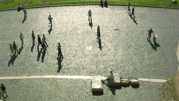 Spectators-still-pedestrians-on-plaza-Adj