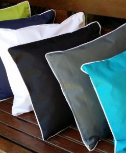 Outdoor cushions with white piping