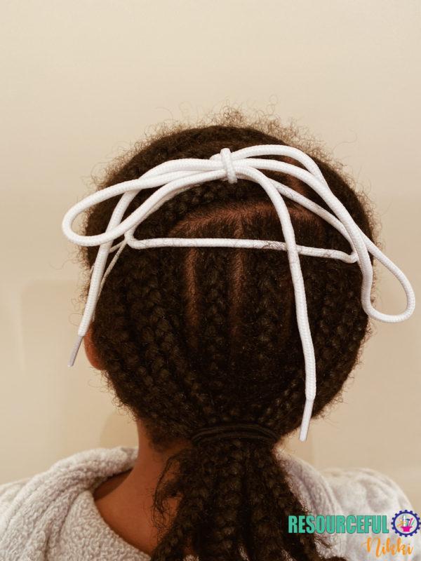tied shoelace ear saver