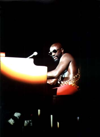"""© John H. White, """"Black soul singer Isaac Hayes performs at the International Amphitheater in Chicago as part of the annual PUSH [People United to Save Humanity] `Black Expo` in the fall of 1973,"""" 1973"""