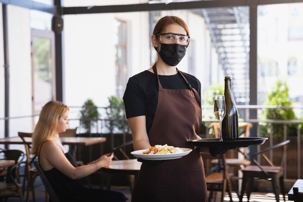 Server wearing personal protective equipment