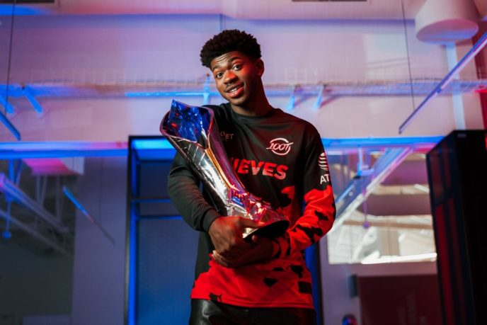 Lil Nas X holding LCS trophy