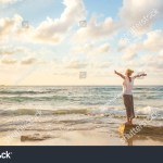 stock-photo-relaxed-woman-enjoying-sun-freedom-and-life-an-beautiful-beach-in-sunset-young-lady-feeling-free-1722727303