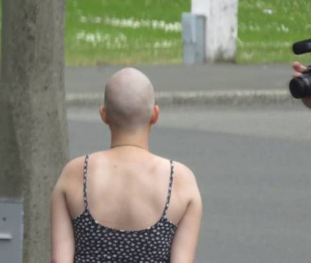 Backpackers Have Been Paid By A Mysterious Benefactor To Have Their Hair Shaved Off