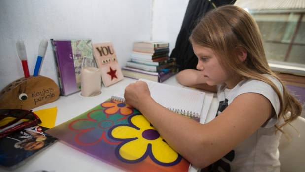 Kayla Morrison's school desk is in her bedroom. The 12-year-old tried school for a year when she was eight but prefers ...