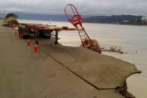 Damage at Centreport, after 15 square metres of sea wall and road slumped into the sea at the southern end of the ...