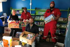 Kaikoura Suburban School principal Hayden van Lent and his partner Nicky Carr receive more supplies for food parcel ...