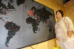 Country Kai Cafe owner Marie Flowerday in front of the map where travellers stopping in at the Seddon business put their ...